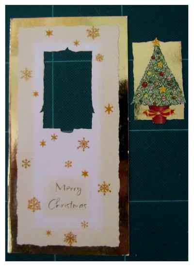 The main picture with the dove was cut from an old Christmas card & mounted on to another piece of orange card. It was then affixed to a blank card & embellished with ribbon and stickers.
